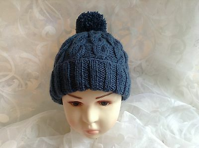 HAND KNITTED CHLDS BOB HAT CABLED BLUE. AGE 0-3mths3-6mths6-12mths 1-2 &3-4 yrs