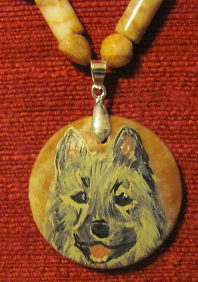 Norwegian Elkhound hand painted on a Redline Marble pendant/bead/necklace