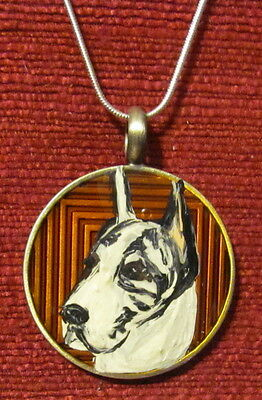 Great Dane - harlequin- hand painted on round metal pendnant/bead/necklace