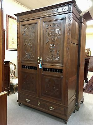 Carved Scenic European Armoire depicting Dutch Scenes