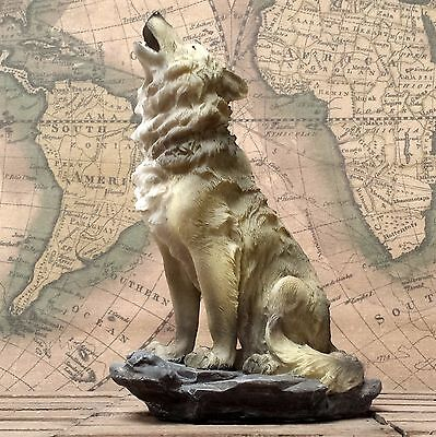 Howling Wolf sitting on the rock - ornament, figurine