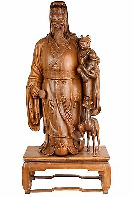 China 20. Jh. Große Holzfigur -A Large Chinese hardwood Figure of Luxing Chinois