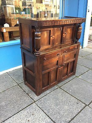 Solid oak court cupboard with 4 cupboard doors and 2 drawers #1257