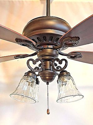 """52"""" ORB oil rubbed bronze ceiling fan with 4 light clear wavy glass"""