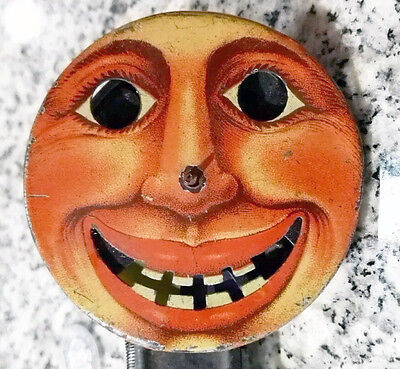 Rare Antique Litho Tin Sparkler  Face Push Action Spinner Toy Noisemaker Vintage