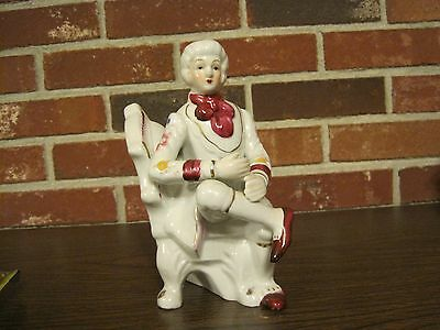 Vintage Ceramic / Porcelain White And Burgundy Male Figurine Sitting In A Chair
