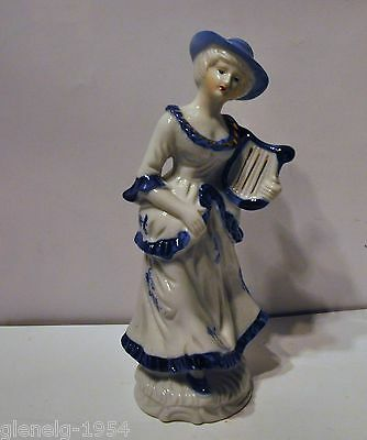 Porcelain Colonial Blue And White Lady Figurine Vintage hallmarked on the Bottom