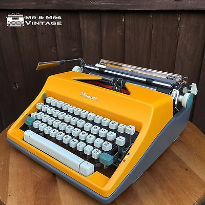 1965 Olympia SM9 Yellow typewriter serviced working vintage ribbon black red