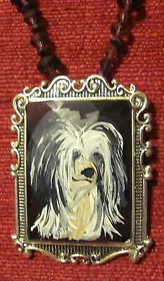 Chinese Crested hand painted on a rectangular glass pendant/bead/necklace