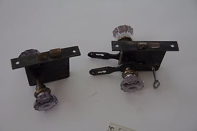 Antique amethyst purple glass and metal door knobs with metal casing