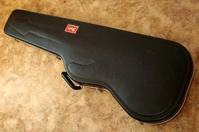 Black molded Fender red label hard shell case for Jazz/precision bass guitar