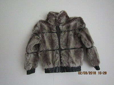 Next 7-8 years old girl coat. brown; made in China
