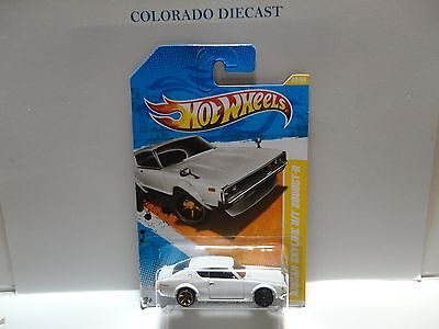 2011 Hot Wheels #22 White Nissan Skyline H/T 2000 GT-R ERROR w/Mismatched Wheels