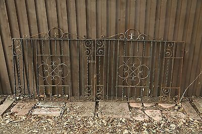 2 Vintage Heavy Iron Gates 46 inches high by 48 and 56 inches wide.