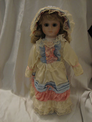 Genuine Porcelain Doll Blond Hair in a Pink, Blue, and White Dress
