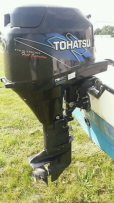 Tohatsu outboard motor 25Hp four stroke electric start with remotes longshaft.