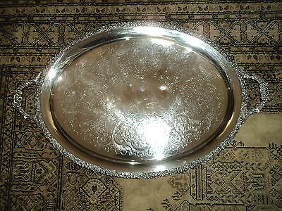 A large vintage silver plated serving tray with very elegant patterns