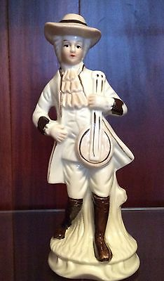 Brown & White Man holding instrument Figurine Made in Taiwan