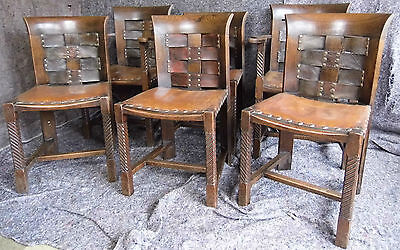 A Set Of Six Oak & Leather Arts & Crafts Dining Chairs