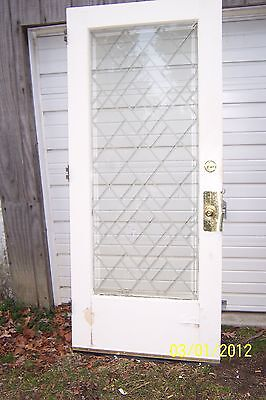 Exterior Bevelled Glass Door With Designs On Glass