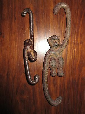 2 cast iron antique pot hanger monkeys