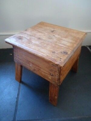 Old antique style square pine planked rustic stool