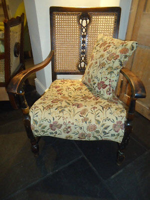 Early C20th carved and cane back bergere open fireside armchair for upholstery