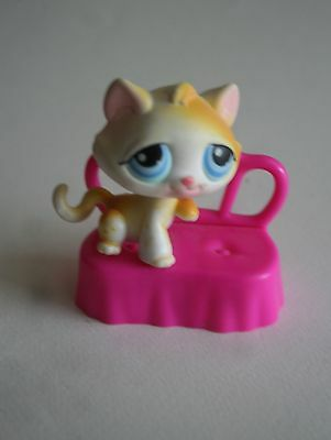 A Baby Pet Cat with a Pink Bed from the Littlest Pet Shop