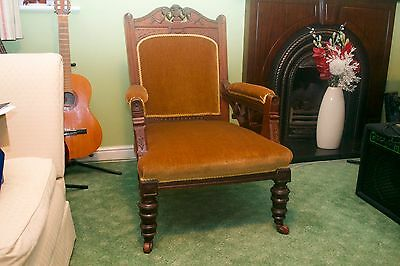 Antique carved mahogany fireside Armchair or Nursing Chair