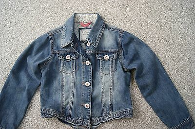 Girls denim jacket from Next in size 7-8 years with Turtle patches on back
