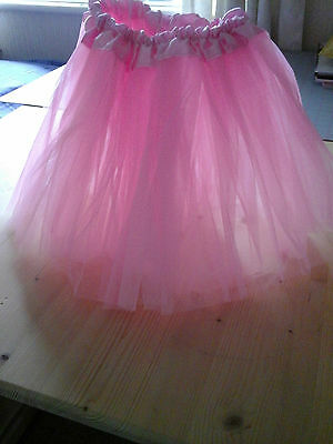 Pink Tutu 11 ins long. tulle with satin. For all ballerina's and dressing up.