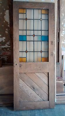 solid oak door with stained leaded glass