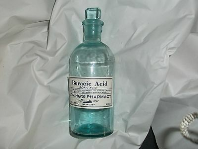 apothecary jar in blue glass