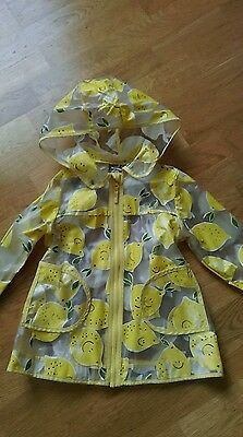 Next, girls mac, raincoat, yellow lemons. Age 4-5.