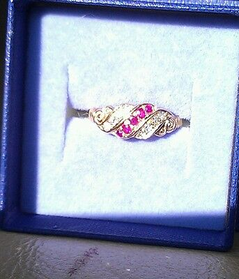 An antique ruby and diamond band style ring in 18ct gold