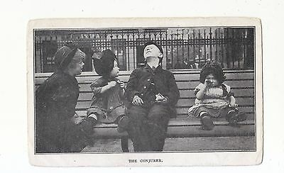 Charming Postcard Of A  Group Of Street Children-The Conjurer