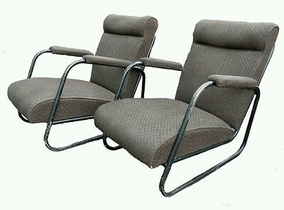 A pair mid-century tubular lounge armchairs, in the manner of Bauhaus