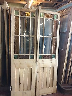 A Pair Of Coloured Glass Doors