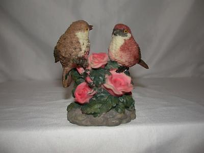 Resin Bird Figurine With Two Birds Perched On Flowers