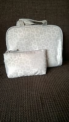 Leopard print toiletry bags