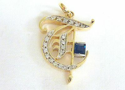 "14 Kt yg Cursive ""T"" Pendant Diamonds and Sapphire open work 1"" I-3739"
