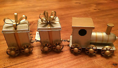 Silver and gold Christmas present train