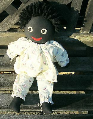 traditional black doll in yellow pyjamas 16 inches