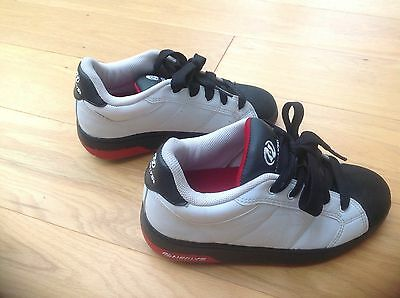 White and black size five heelys