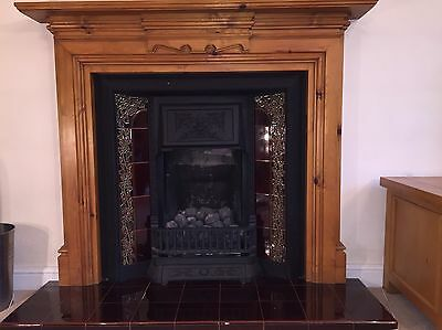 Cast iron fire insert and pine surround