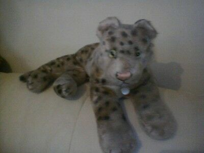 Vintage Hermann leopard with id chest disc