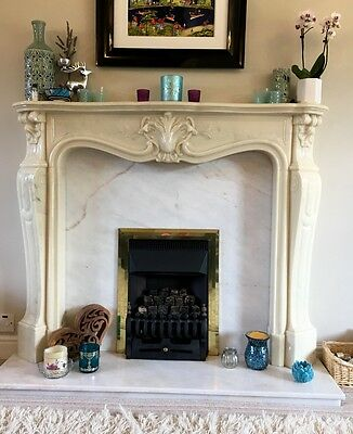 cream composite marble effect fireplace surround
