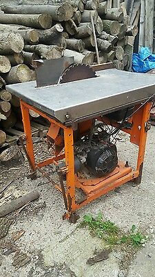 petrol bench saw  woodworking logs logging timber forestry