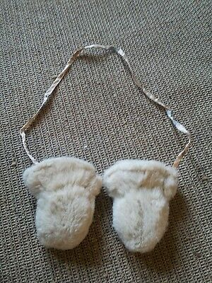 Gorgeous babies/toddlers furry mittens with safety string