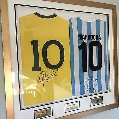 autographed pele and maradona shirts in frame